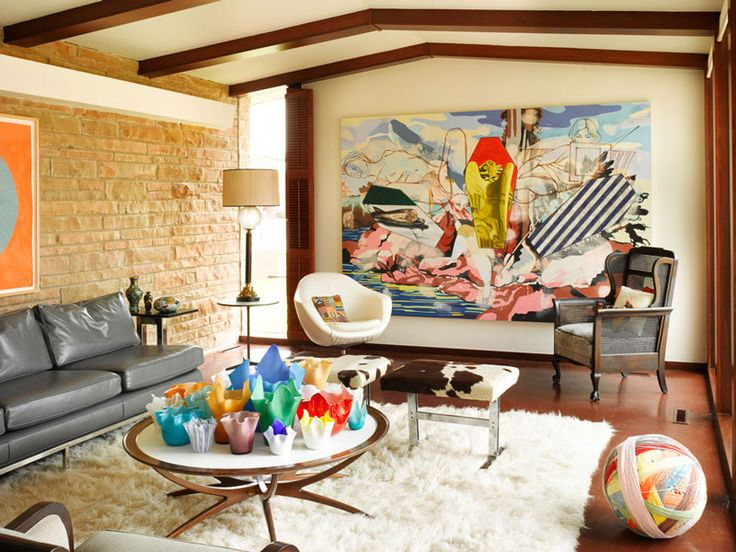 Funky living room with mix/matched colors and textures.