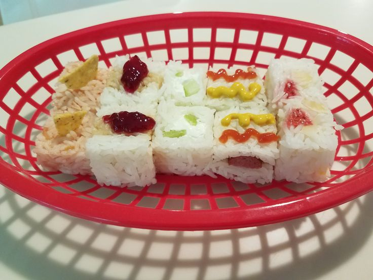 Picnic Sushi --- I made this for a dear friend's birthday lunch - Sushi from left to right: Salsa & Chips, PB&J, Cucumber & Cream Cheese, Hotdog, Fruit Salad