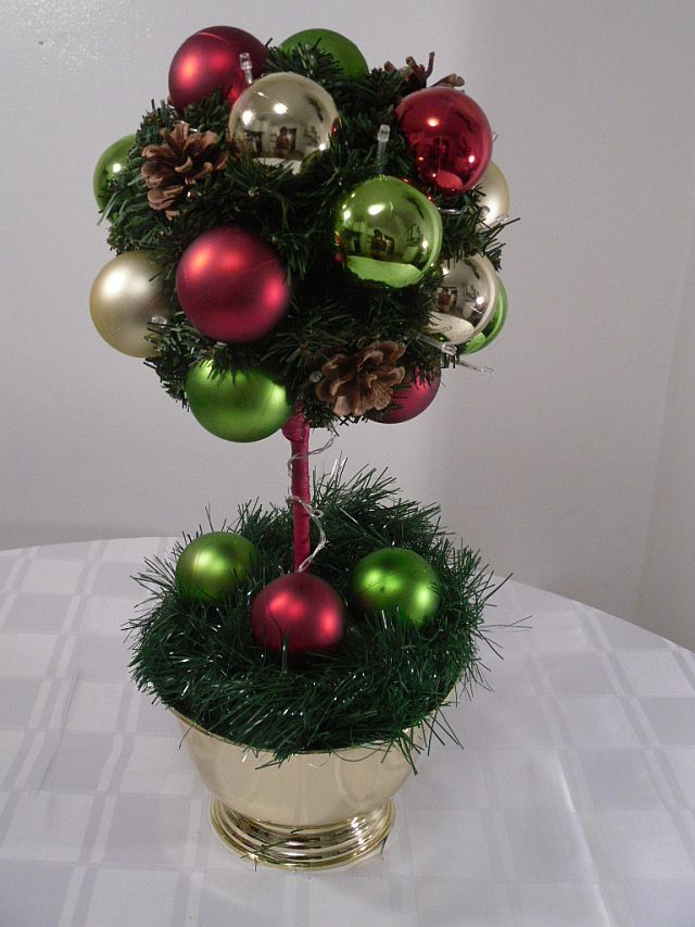 Christmas Centerpiece, Ornament Topiary Tree, Pre-Lit Holiday Centerpiece, Red LED lights. $40.00, via Etsy.