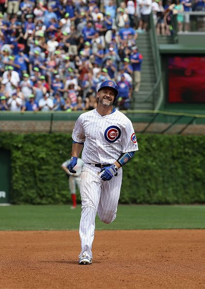 David Ross of the Chicago Cubs smiles as he runs the bases after hitting the 100th home run of his career in 4th inning against the Philadelphia...