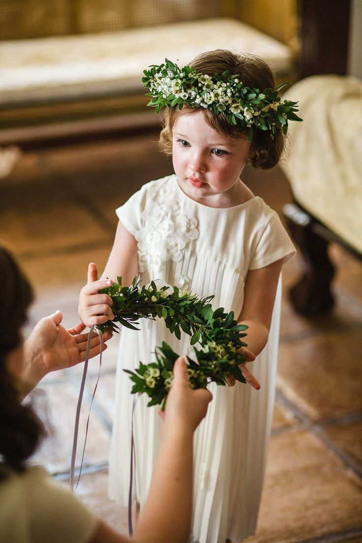 Flower girl wears a white flower crown. Photography by Radka Horvath