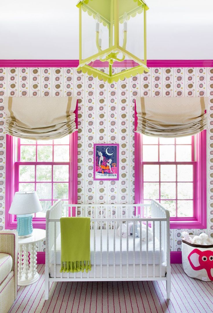 Adorable fuchsia and green nursery features walls covered in pink and green  wallpaper accented with crown moldings, baseboards and window moldings  painted ...