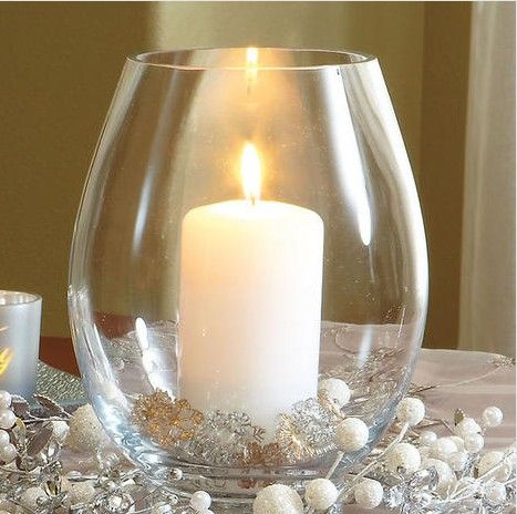 """Hurricane and Snowflake Scatters Set from Lillian Vernon.  Create an instant seasonal display that is sure to enliven your decor in any room. Stunning thick glass hurricane comes with 12 gold and silver highlighted snowflake scatters in 3 shapes plus our 3 x 6"""" white pillar candle that burns up to 70 hours.  Get your rebate from RebateGiant."""