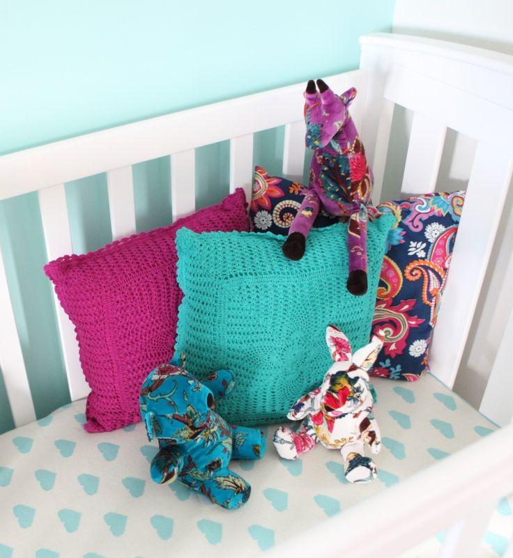 Sweet Heart babies blanket, surrounded in soft velvet toys and crochet cushions. www.rosaliving.co.nz www.rosaliving.com.au