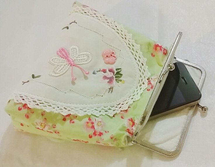 Purse made with recycled vintage doily, tilda fabric & a few embellishments using a metal sew-in frame.
