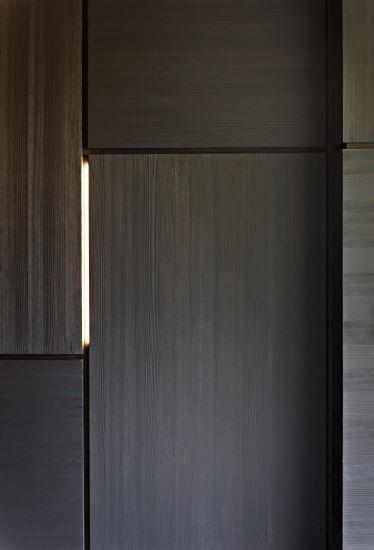 Wall Detail - dark wood veneer and Led strips - La Reserve residence in Knokke Belgium by Isabelle Onraet