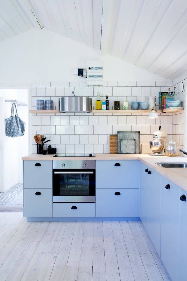 Pale Blue Modern Kitchen Cabinets With White Tile And Opening Shelving