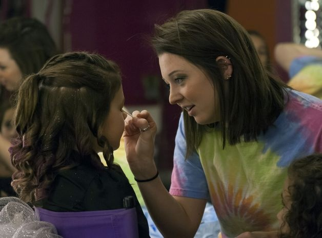 "11 year-old Saide (left) has some make-up applied by stylist Ashta Ermis (right) as one of friends looks one during her ""glamour girl"" birthday party at Sharkey's Cuts for Kids March 10, 2013. Photo: Steve Faulisi, San Antonio Express-News / ? 2013 San Antonio Express-News"