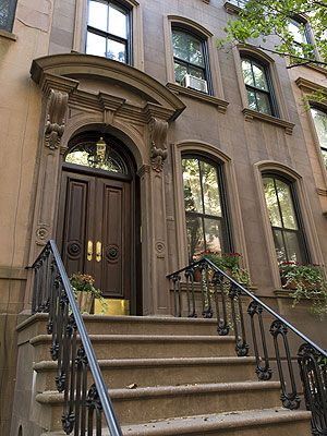 """Love the doors! The townhouse that served as the original setting for Carrie Bradshaw's home in """"Sex and the City"""" is listed for sale in New York."""