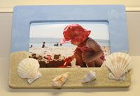 Favor? Make your own beach picture frame. Baskets of shells can be found at the Dollar Store. Paint and Sand can be bought cheap at Michael's.