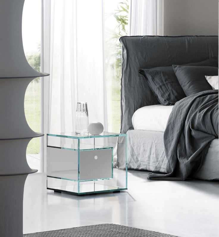 Glass nightstand design for the modern bedroom | www.bocadolobo.com #bocadolobo #luxuryfurniture #exclusivedesign #interiodesign #designideas #bedroomdesign #nightstandsideas #bedsidetabledesign #glassnightstand #glassnightstanddesign