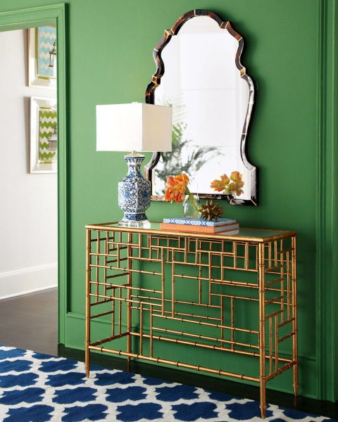 A kelly green hallways works well with blue, orange, gold and natural materials like horn and bamboo. Click through for more green decorating ideas.