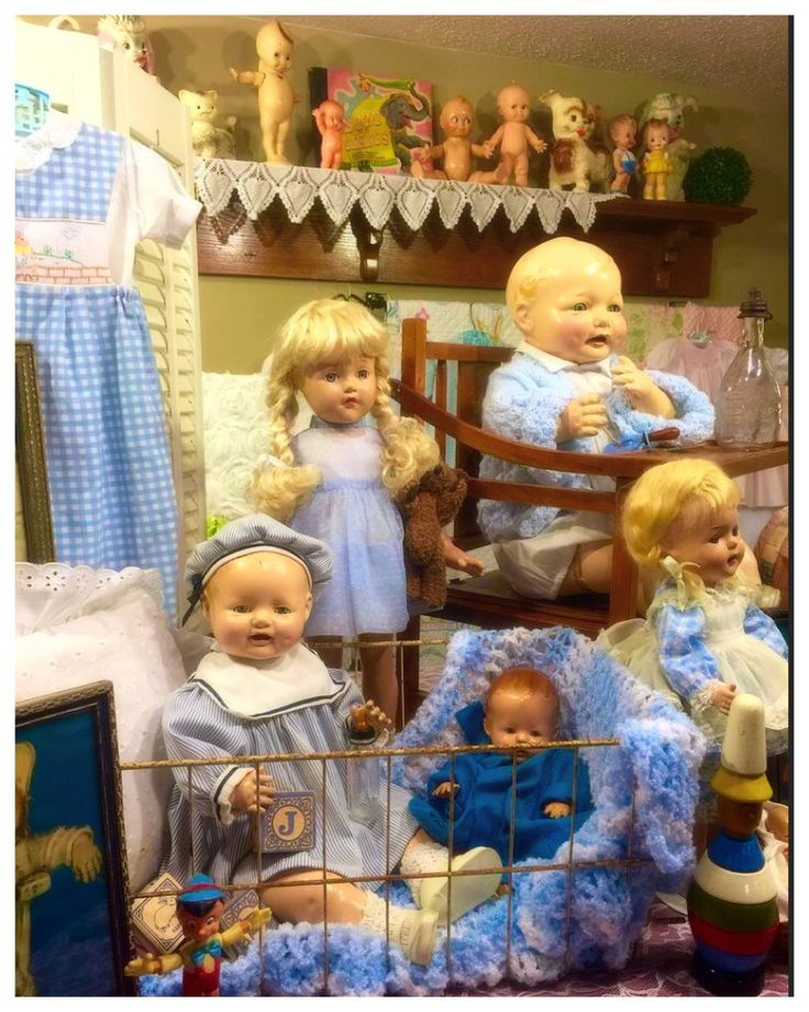 Vintage dolls and accessories in doll room