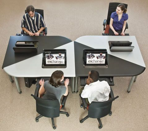 At the Exchange collaboration table, work alone or in groups; the desk lets you decide.