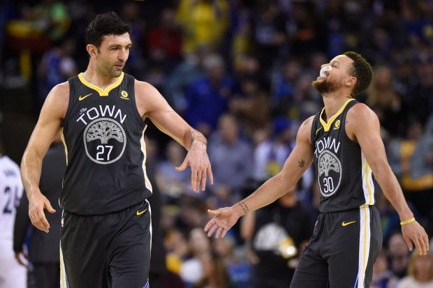 Golden State Warriors' Zaza Pachulia (27) congratulates teammate Golden State Warriors' Stephen Curry (30) during the second quarter of their NBA game at the Oracle Arena in Oakland, Calif., on Saturday, Dec. 30, 2017. (Jose Carlos Fajardo/Bay Area News Group)