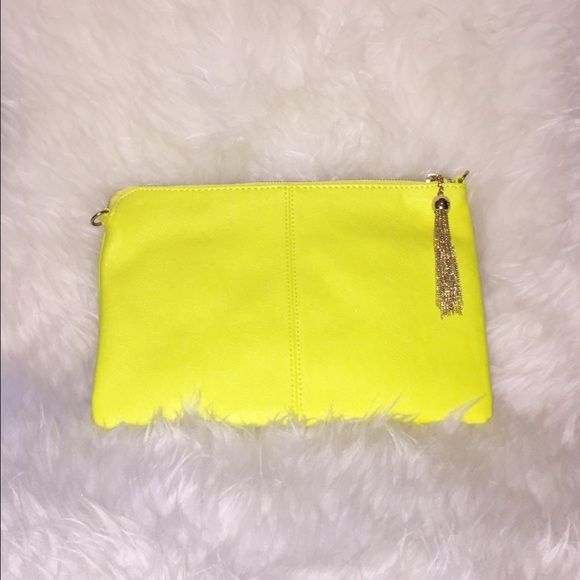 Neon Yellow Clutch Bag Neon Yellow Clutch with Gold Tassel. Pair this clutch with our neon yellow and gold fringe necklace set for a sexy spring look. Bags Clutches & Wristlets