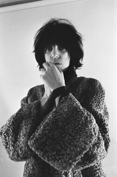 Top to Bottom: Patti Smith, Michael Ochs Archives, 1974 / J.W. Anderson Boucle Rounded Raglan Sleeve Coat/ Saskia Diez Wire Ring Taking notes from Patti Smith. -Lauren