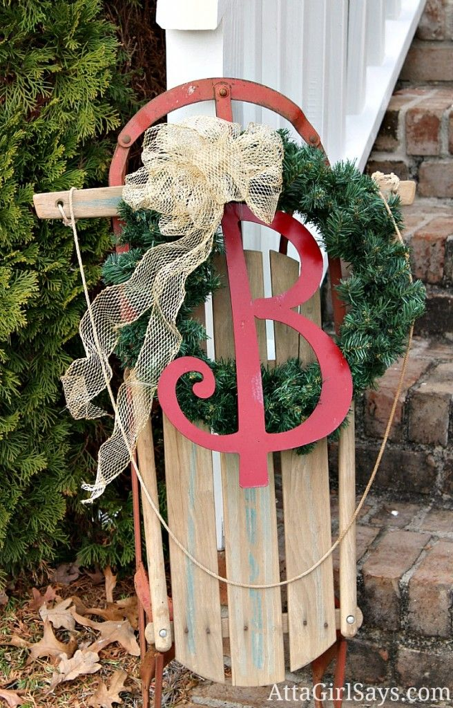 decorated Christmas sled with monogram...we have a sled, what a great idea for the holidays!!