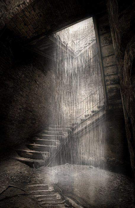 Rain falling down a staircase at the ruins of the tuberculosis sanitarium at Beelitz Heilstätten, Germany.
