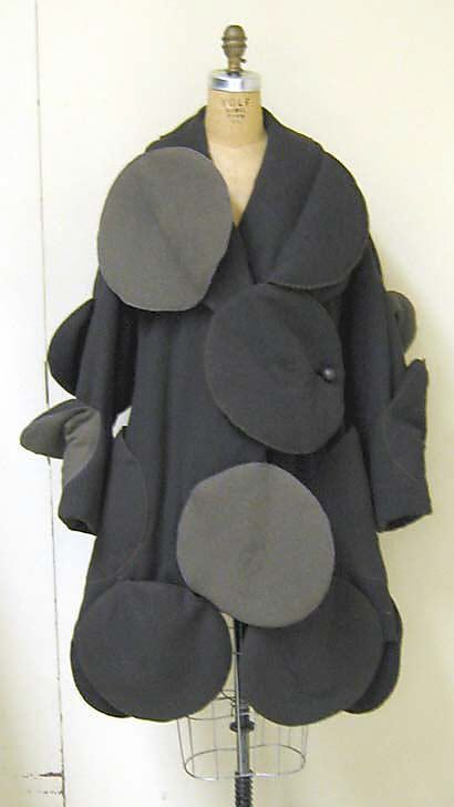 Coat  Issey Miyake  (Japanese, born 1938)    Design House:      Miyake Design Studio (Japanese)  Date:      fall/winter 1990–91  Culture:      Japanese  Medium:      wool blend; synthetic  Dimensions:      Length at CB: 40 in. (101.6 cm)  Credit Line:      Gift of Muriel Kallis Newman, 2006  Accession Number:      2006.74.23    This artwork is not on display