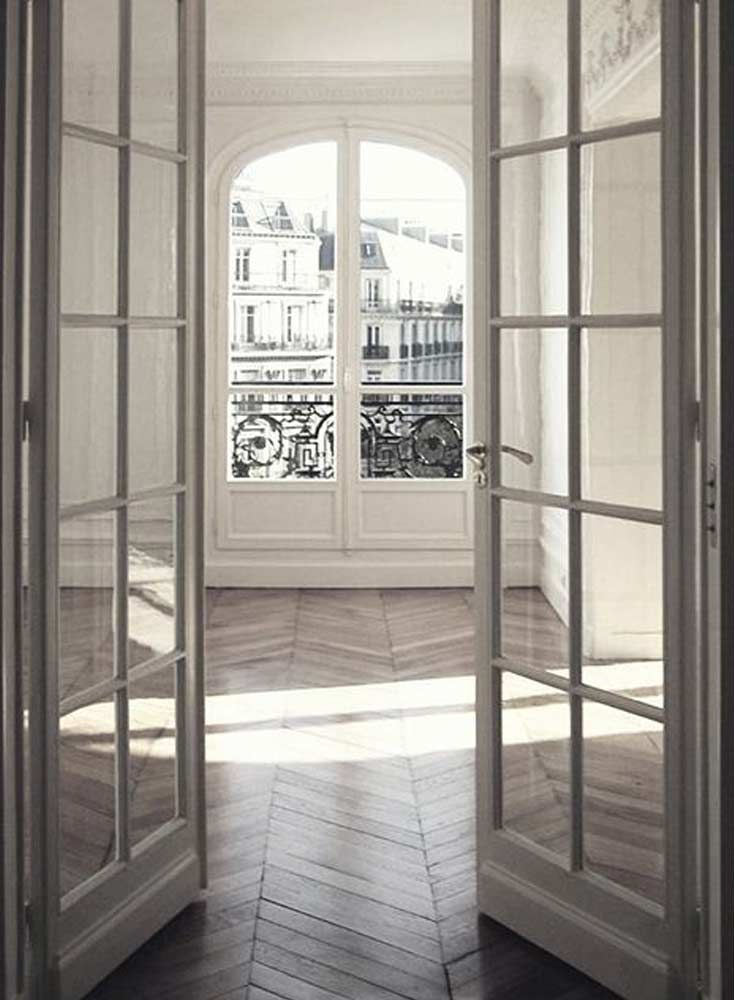 The French Bedroom Company Blog Gives their tips on How to Style Your Bedroom Like a Parisienne. Paris home with high ceilings, white walls, parquet flooring, large windows and paris view. Imagine breakfast in paris in this paris house apartment in the Haussmann designed city