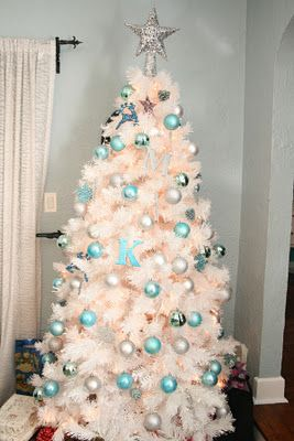 white christmas tree with shades of blue, aqua, silvery ornaments