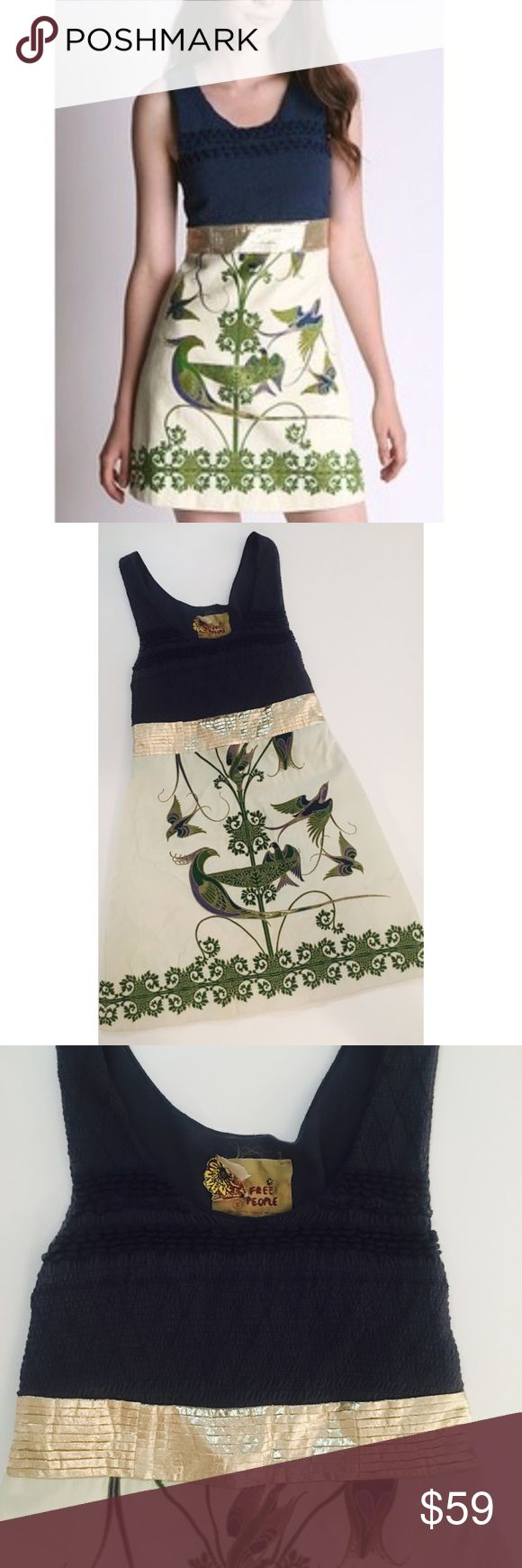 Free People Bird of Paradise Dress Size 8 Free People Bird of Paradise Dress. Ivory/Cream A-Line Dress with Navy Blue Smocked Top and Gold Metallic Center. Beautiful & Vibrant Ornate Bird Design with Rhinestone Embellishments. 100% Cotton. 33 inch length. Fabulous Pre-Loved Condition.   All items come from a smoke free home and are shipped on the same or following day an order is placed.   Items are shipped in polymailers placed INSIDE boxes to ensure all purchases are completely protected…
