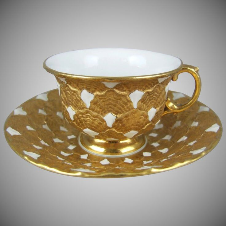 Meissen porcelain cup and saucer set features a stylized clam shell motif that was first made at the Meissen manufactory in 1839. Heavy gold and white teacup and saucer. Coffee Cup.