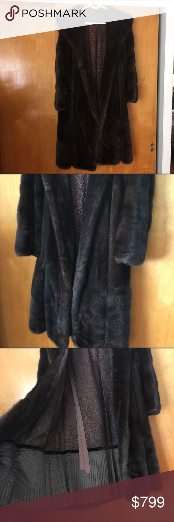 Mink fur coat Pristine women's knee length mink coat !! 100% real mink !! The overall condition is excellent. It fits like a size 6US. the only thing wrong with it is the little loop inside for the button. It just needs to be sewn back in. That's it. Condition is amazing !!! I'm unsure of the year or purchase. This coat looks brand new though ! 45 inches in back length Jackets & Coats