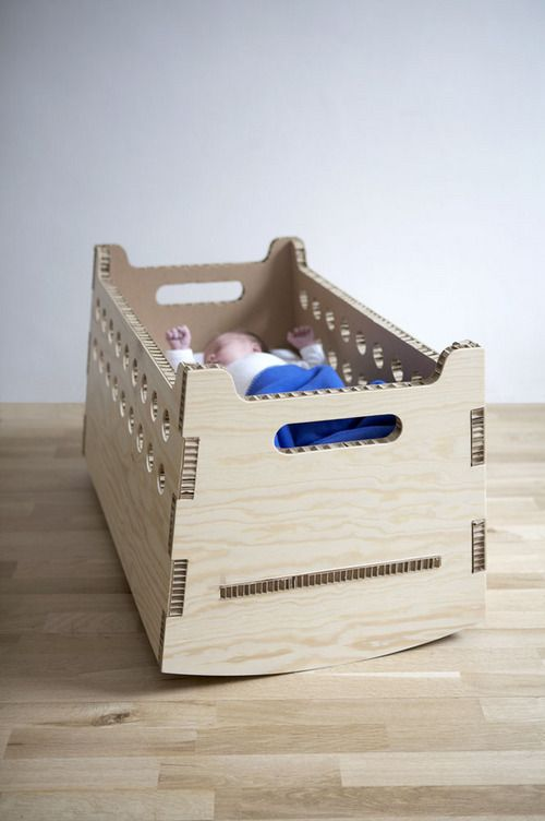Cradle made from five flat pieces of plywood laminated cardboard. First prototype in use by Onno Calvelo.