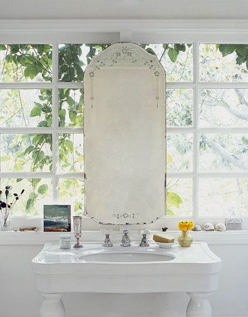 our bathroom has a window where we need a mirror. Solution?