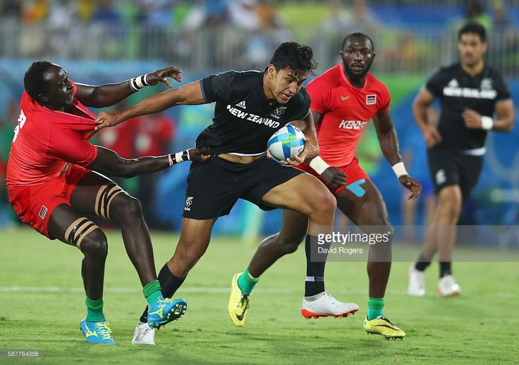 Rieko Ioane of New Zealand holds off Humphrey Kayange of Kenya during the Men's Rugby Sevens Pool C match between New Zealand and Kenya on Day 4 of the Rio 2016 Olympic Games at Deodoro Stadium on August 9, 2016 in Rio de Janeiro, Brazil.