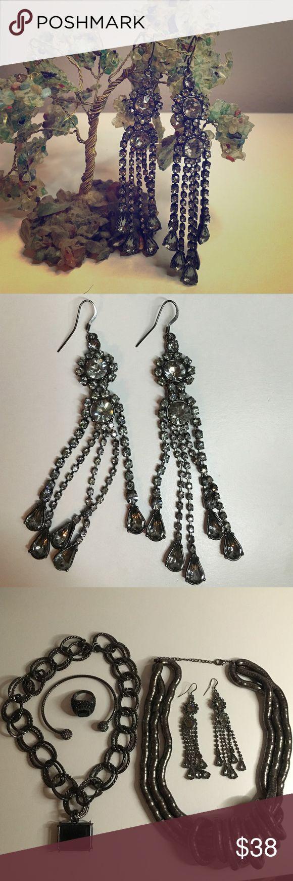 Dramatic Dangles: BCBGMAXAZRIA Look glamorous in these head turning drop earrings for any party or cocktail event. These earrings sport a shiny gunmetal finish that will sparkle in the darkest of venues. Earrings hang about 4 inches long BCBGMaxAzria Jewelry Earrings