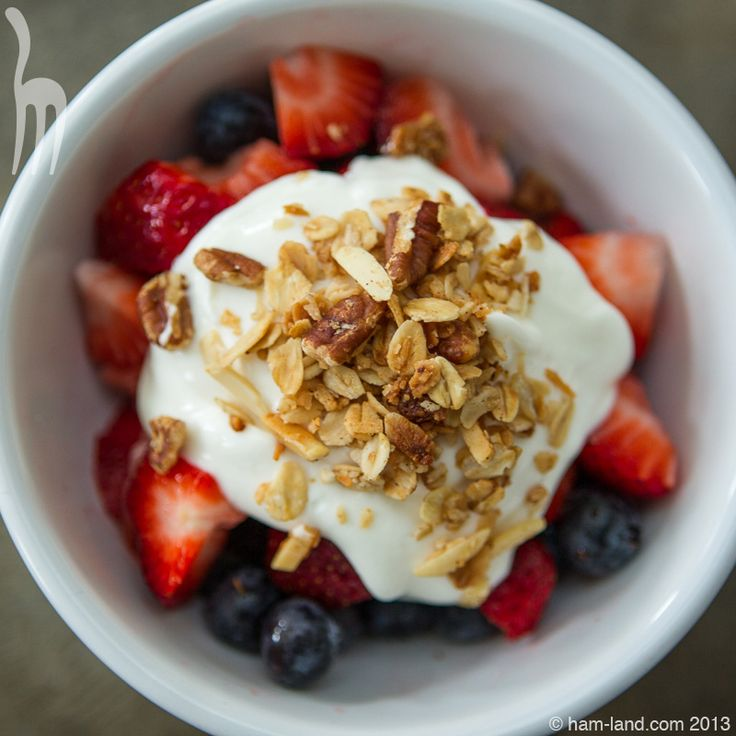 Almond Crunch Granola with Fruit and Yogurt in Bowl