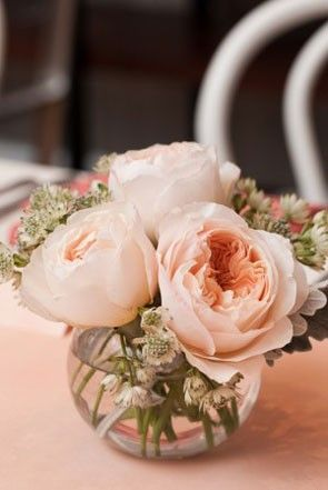 The pale peachy pink garden roses on the left are best complemented with a clear vase unless you want them to have a cream appearance | See more pretty in pink centerpieces here: http://www.mywedding.com/articles/pink-wedding-centerpieces/?utm_source=pinterest&utm_medium=social&utm_campaign=decor_details