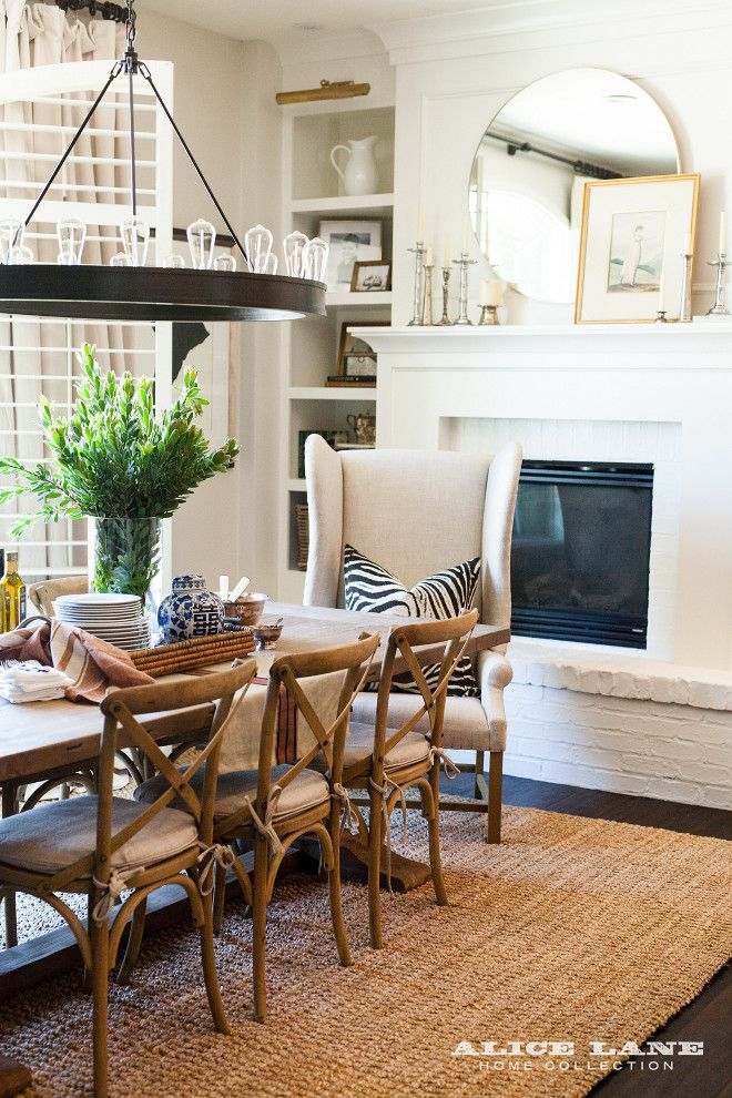 Layered Farmhouse Breakfast Nook With Sisal Rug Wingback Dining Chair Trestle Table And Industrial Chandelier