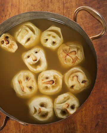 Shrunken Heads in Cider. 2 cups spiced rum, 2 gallons apple cider, 2 cans frozen lemonade concentrate, 32 whole cloves, 8 large granny smith apples, 2 tbsp coarse salt and 2 cups of lemon juice.