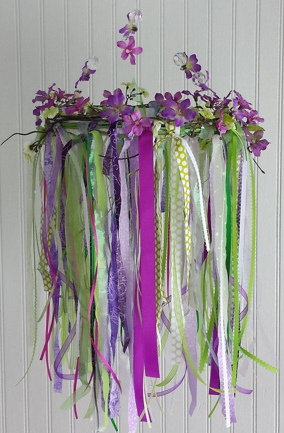 """One-of-a-kind, custom-made hanging mobile inspired by Tinkerbell, Pixie Hollow, and all things """"little girl!"""" Perfect for baby nursery, child's bedroom, play room, porch, or any space that could use a pop of color and an increased sense of calm.  www.teetu.etsy.com"""