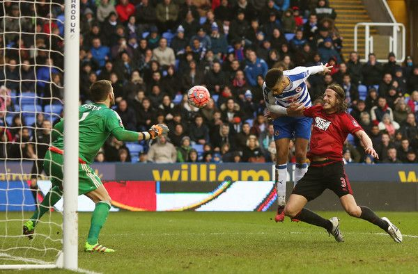 Reading's  Michael Hector heads in at the far post to put his side into the lead against West Bromwich Albion in the  FA Cup Fifth Round