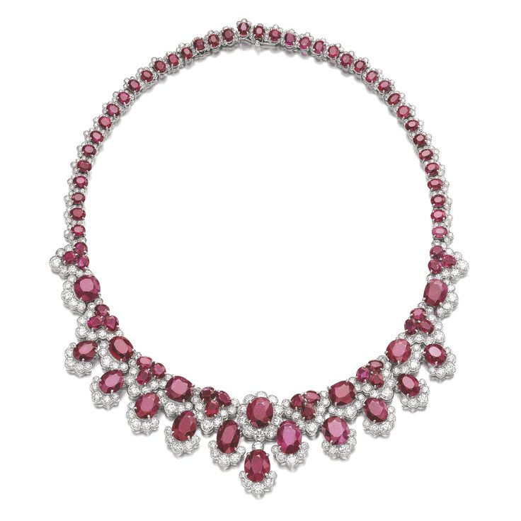 RUBY AND DIAMOND NECKLACE, BULGARI, CIRCA 1960 Designed as a graduated fringe of oval and cushion-shaped rubies, highlighted with brilliant-...