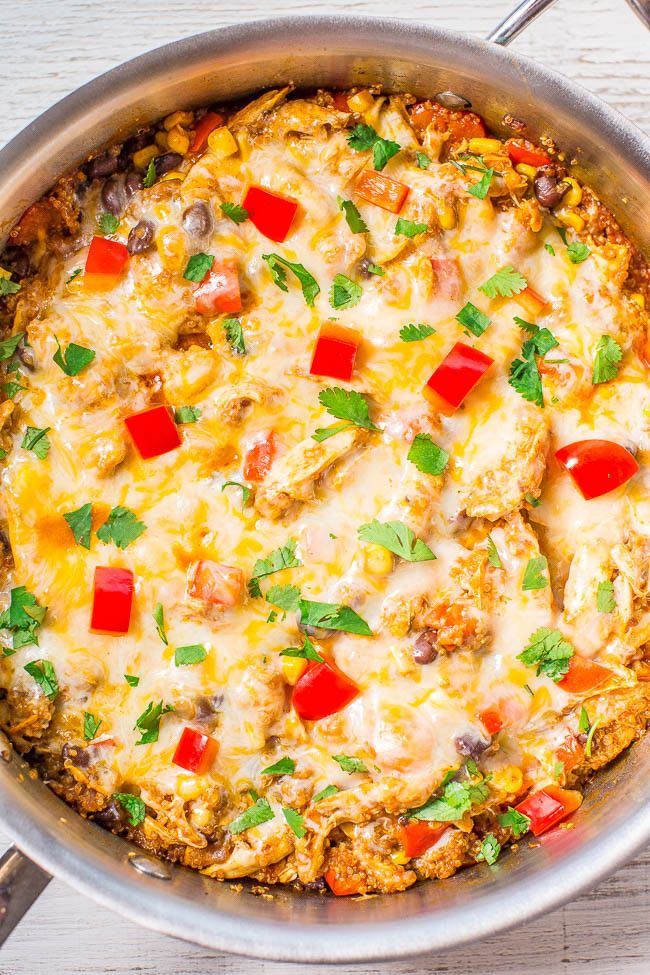 Cheesy Chicken Enchilada Quinoa - All the flavor of chicken enchiladas, minus the work of rolling them!! Juicy chicken, corn, black beans, peppers, and loads of melted cheese! Easy, one-skillet, and ready in 30 minutes!!
