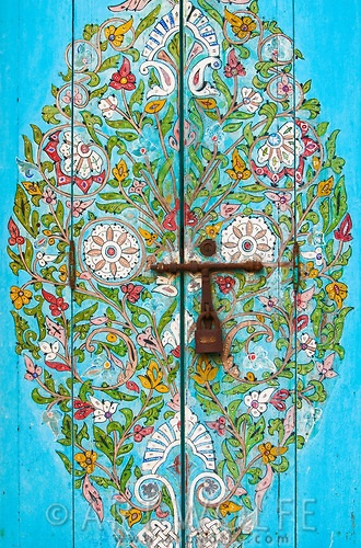 Incredibly beautifully decorated door.