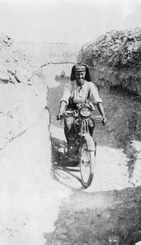 GALLIPOLI 1915. Despatch rider of the Royal Naval Division Signal Company returning through a communication trench from Brigade Headquarters.