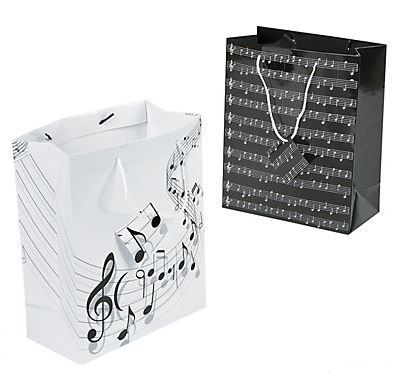 Music Gift Bags with handles (12) .  Hit the hight notes with these cute Music Gift Bags!  These medium sized Music Themed Gift Bags feature music notes. Perfect for giveaways at parties, or for gifts at themed parties. Perfect for anyone who loves music.  Assorted designs; Paper. 19cm x 22.8cm with 15.2cm handles  Price is for a set of 12