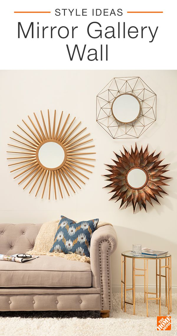 Switch up your wall decor and create a bold gallery wall using mirrors. A creative alternative to art and photos, mirrors will reflect light through the room, making it appear more open and airy. Mix different metals, shapes, and sizes to achieve this on-trend modern look. Click to explore this stylish space.