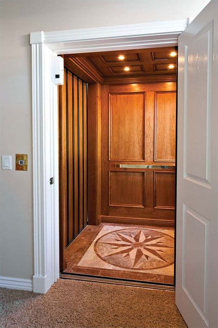 Safe room elevator hidden behind a door add emergency for Elevators home