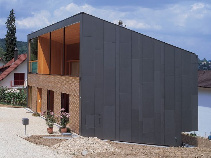 Nice contrast of dark grey metal cladding with larch for Modern house cladding