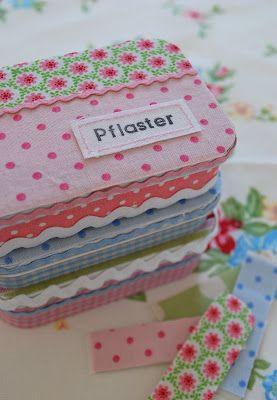 DIY Mit Stoff beklebte Dosen...sehr nett und eine tolle Idee  http://mamaskram.blogspot.com/