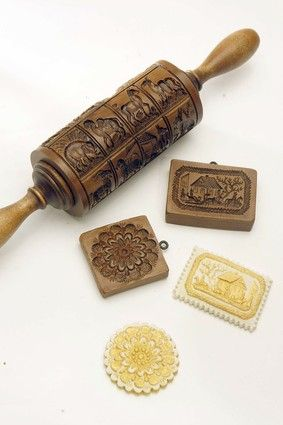 Springerle cookie molds. I keep hoping som elderly German woman will have a box of these at a garage sale :) I can hope.