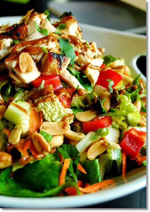 Thai Chicken Salad - vegetable oil - rice vinegar - sugar - garlic clove - cilantro - lime - chicken - romaine - head of Napa cabbage - cucumber - carrots - red bell pepper - green onion - salted peanuts - Thai sweet red chili sauce - sesame oil